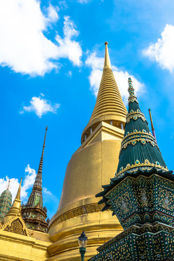Ancient Culture Architecture Blue Buddhism Cloud - Sky Cultures Day Gold Gold Colored Grand Palace Bangkok Thailand History No People Outdoors Pagoda Place Of Worship Religion Religious Architecture Sky Spirituality Statue Stupa Thailand Traditional Culture Travel Travel Destinations