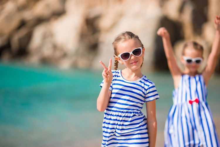 Portrait of boy wearing sunglasses standing at beach