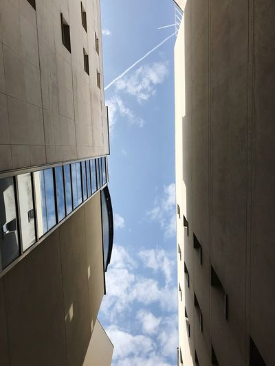 Look at the sky 🇫🇷 EyeEm Selects Sky Low Angle View Architecture Building Exterior Built Structure Cloud - Sky Day No People Nature Building Outdoors Sunlight Blue Wall - Building Feature Directly Below City White Color Tall - High