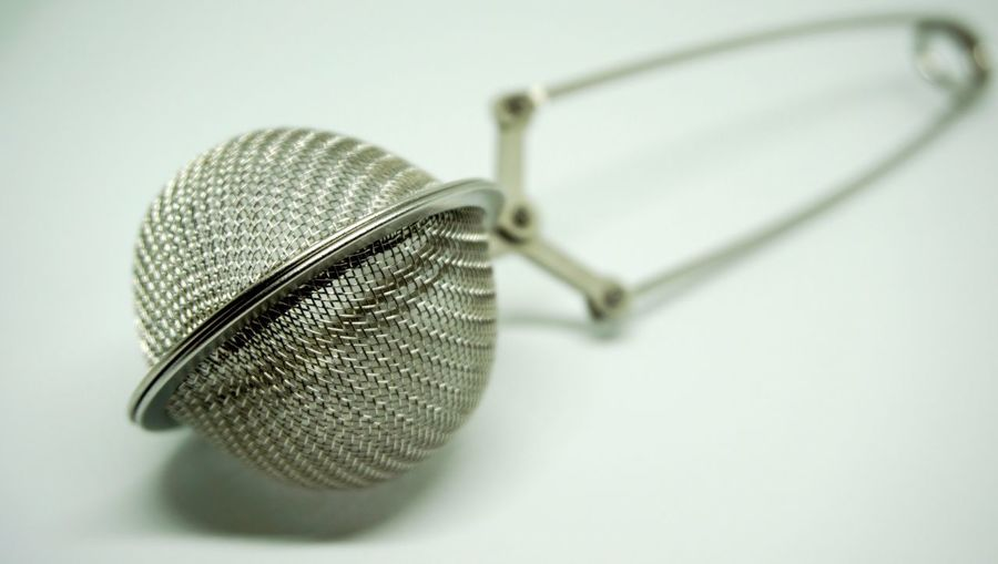 Close-up of tea strainer on table