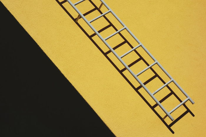Close-up of yellow staircase