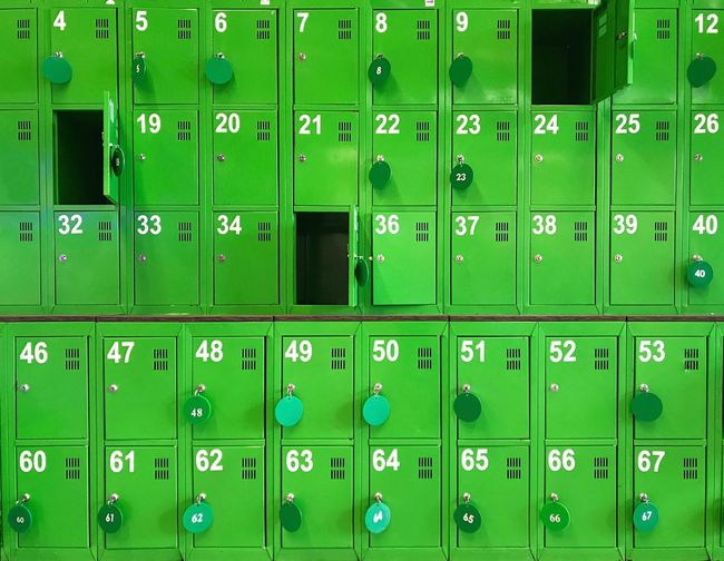 Full frame shot of green metallic lockers