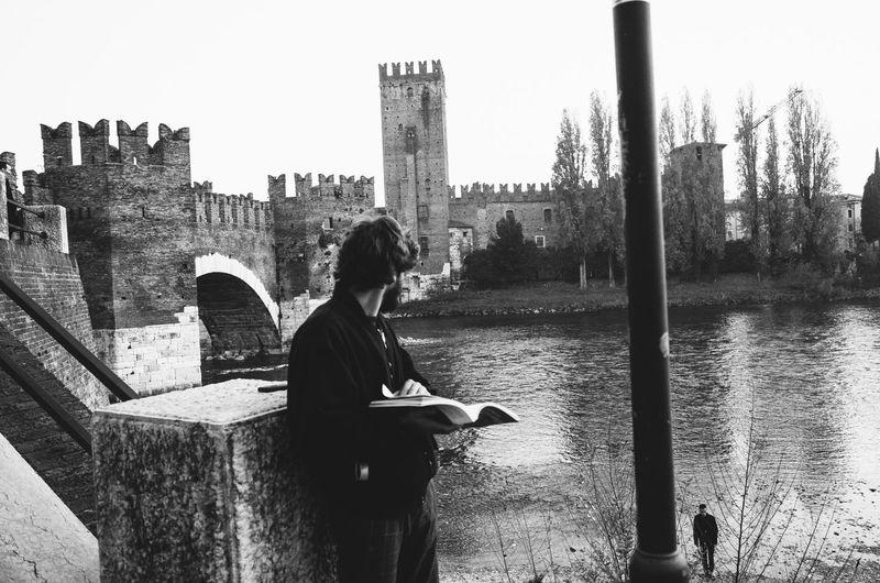 Woman sitting on wall