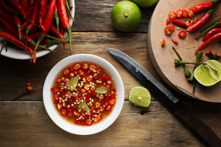 Thai fish Sauce in a cup on wood background Agriculture Chile Chili  Chilli Eating Fish Fish Sauce Fresh Hot Kitchen Kitchenware Lemon Meal Nam Pla Prik Nampla Pepper Raw Ripe Sauce Sauces Slices Spicy Textured  Vegetable Vegetarian