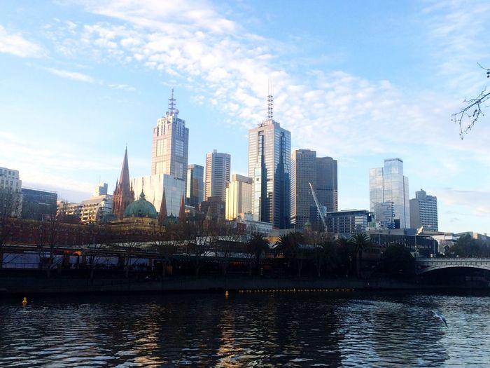 Yarra River By Buildings Against Sky