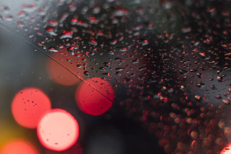 High angle view of raindrops on glass
