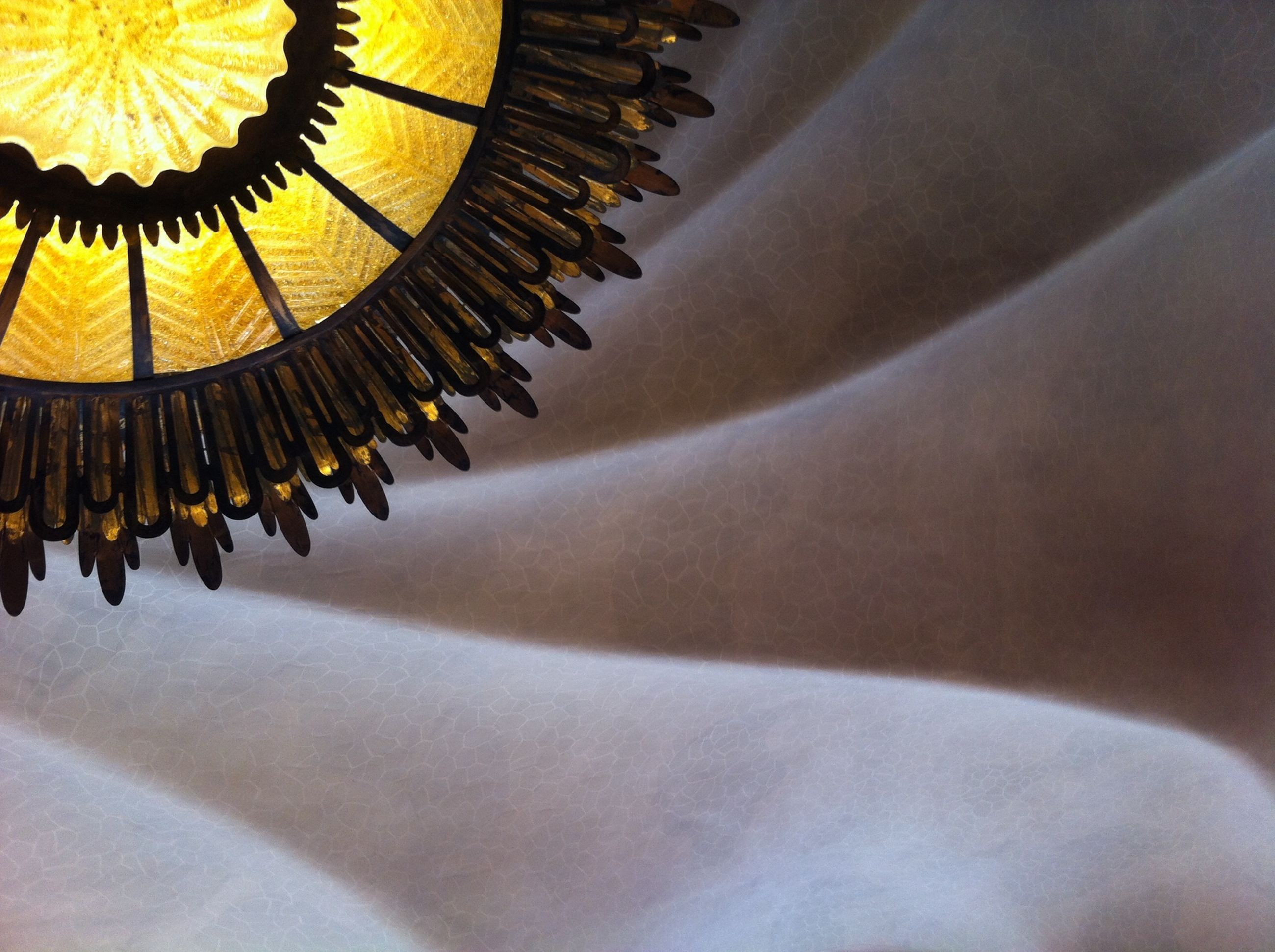 indoors, design, pattern, close-up, no people, low angle view, decoration, spiral, built structure, repetition, ornate, in a row, architecture, arts culture and entertainment, high angle view, spirituality, gold colored, still life, art and craft, religion
