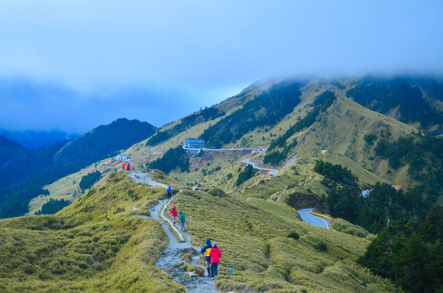 Hikers on their way down from Mt Shihmen Adult Architecture Beauty In Nature Blue Clouds And Sky Day Hehuanshan, Taiwan Hiking Landscape Leisure Activity Lifestyles Mountain Mountain Range Mt Shihmen Nature Outdoors People Real People Scenics Shihmenshan Togetherness Travel Destinations Betterlandscapes The Traveler - 2018 EyeEm Awards