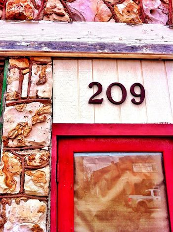 Two-Oh-Nine Architecture Built Structure Building Exterior No People Red Close-up Stone Wall Door 209 Number Textures And Surfaces