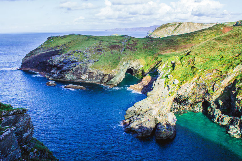 Sea Rock - Object Nature Beauty In Nature Beach Water Scenics Landscape Travel Destinations Outdoors Cliff Aerial View No People Day Sky Horizon Over Water Green Color High Angle View Blue Landscapes Clear Sky Tintagel Castle Beauty In Nature Cloud - Sky Sunlight