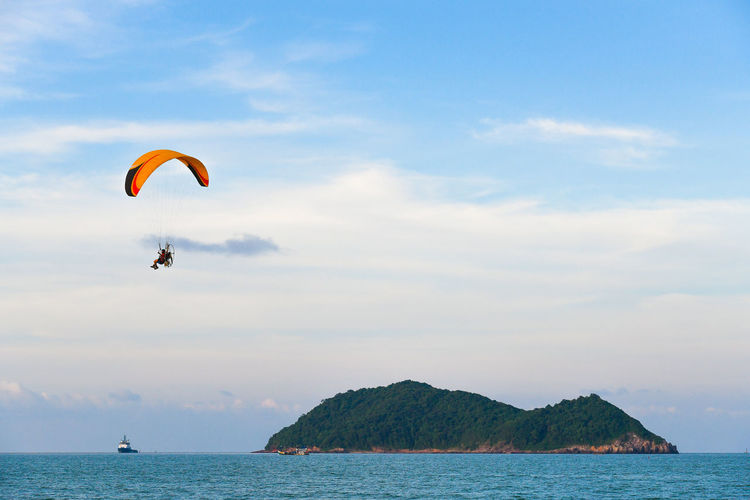 The para motor fly over sea and island Freedom Serenity Travel Activity Beach Beauty In Nature Day Glider Horizon Over Water Island Landscape Leisure Activity Men Mid-air Nature Outdoors Para Motorist Parachute Real People Scenics Sea Sky Sport Tropical Water
