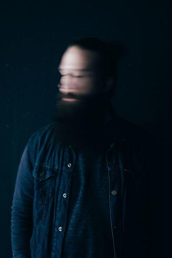 Blurred image of man against black background