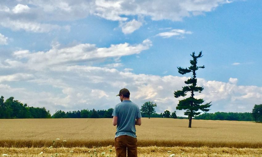 Rear View Sky Landscape Standing Men Leisure Activity Tree Field Lifestyles Walking Boys Casual Clothing Plant Tranquil Scene Tranquility Cloud - Sky Solitude Scenics Day Nature PhotographyLifestyle Photography Travel Photography