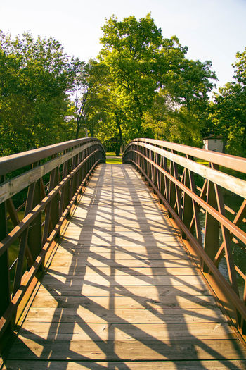 ...over the bridge and through the woods.... Bridge Bridge - Man Made Structure Connection Day Diminishing Perspective Footbridge Nature No People Non-urban Scene Outdoors The Way Forward Tree