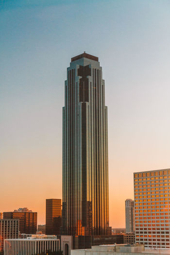 View of skyscrapers against sky during sunset