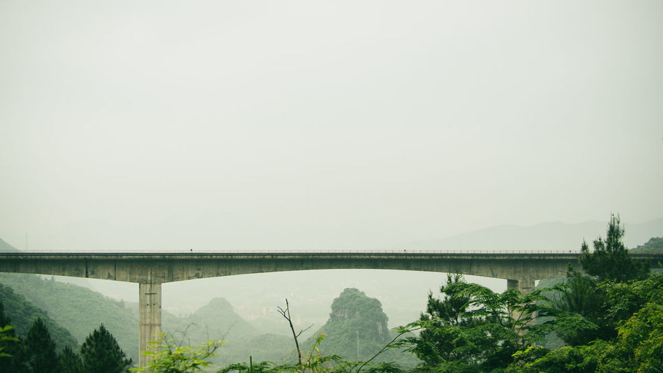 Beauty In Nature Bridge China Clear Sky Green Color Growth Guangzhou Hill Landscape Mountain Nature Non Urban Scene Plant Travel Destinations Tree