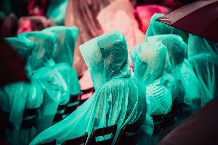 Fans Wearing Raincoat