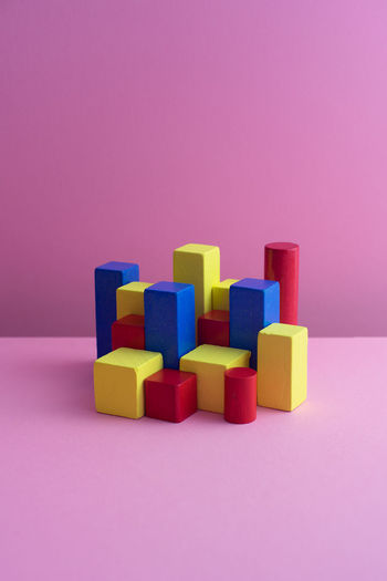 Close-up of colorful toy blocks on colored background