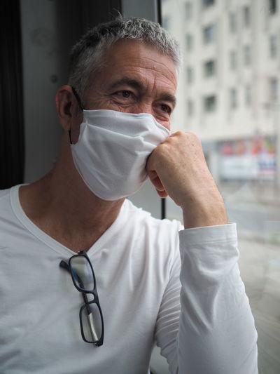 Portrait of man wearing mask in public transport