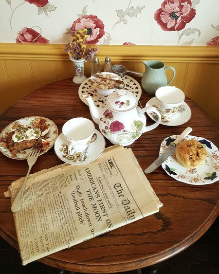 Knott End Cafe English Tradition Cakes Teatime Old Newspaper Beverage Ready-to-eat Plate Selective Focus Refreshment Drink Food Freshness Table Indoors  Food And Drink