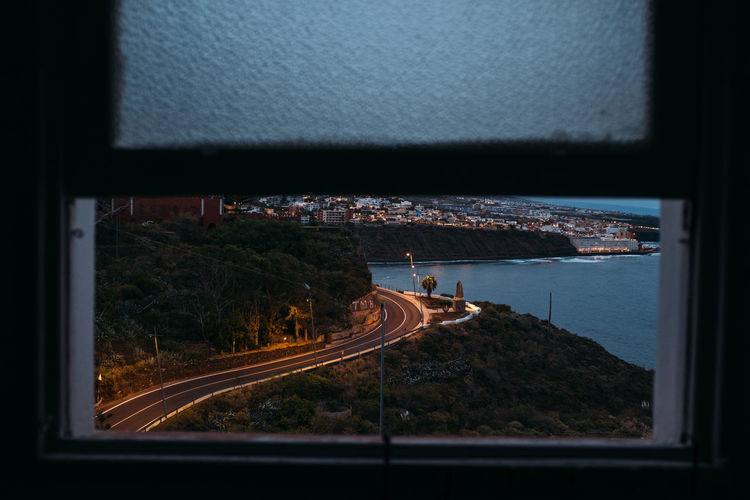 High angle view of road seen through window