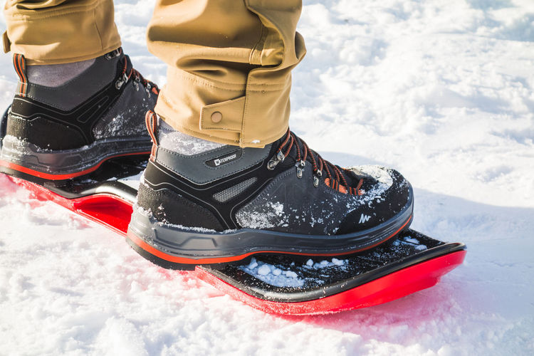Board Slide and Boots Close-Up Snow Cold Temperature Winter Shoe Winter Sport Low Section Sport Leisure Activity Real People Day One Person Human Body Part Human Leg Outdoors Warm Clothing Human Foot Ice Nature Boots Board Slide Slide Board Board Slope Winter Activity