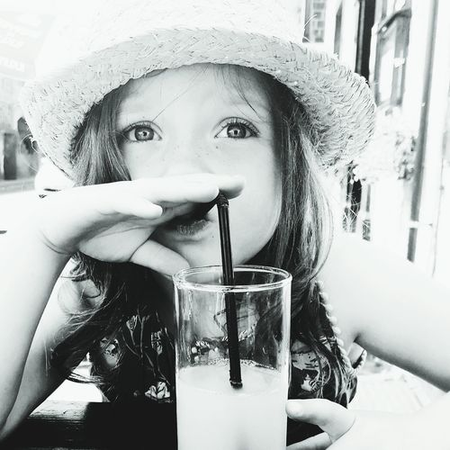 Close-up portrait of girl drinking glass
