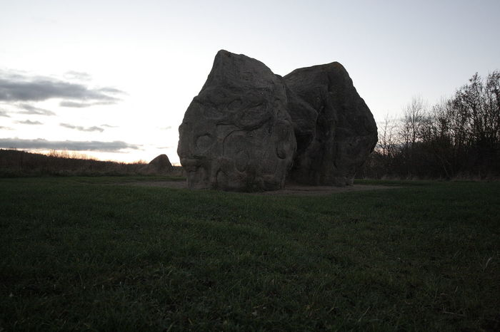 a MONUMENT TO WHO? Rock Outdoors Day Growth Scenics - Nature Non-urban Scene Tree Cloud - Sky Beauty In Nature Landscape Tranquil Scene Environment Tranquility Land Field Grass Plant Sky Nature No People Green Color