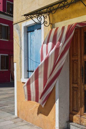 Fluttering curtain on a italian house entrance