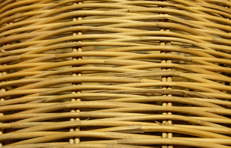 Striped bamboo in the background. Backgrounds Brown Close-up Day Full Frame Gold Colored In A Row Indoors  Intertwined Large Group Of Objects Metal Music No People Pattern Repetition Selective Focus Textured  Wicker Wood - Material Yellow