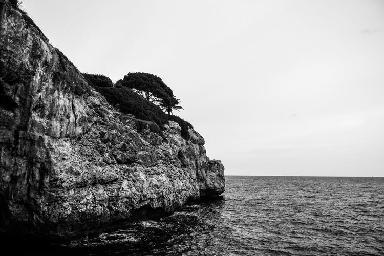 Black & White Beauty In Nature Black And White Cliff Copy Space Day Eroded Land Monchrome Nature No People Outdoors Rock Rock - Object Rock Formation Scenics - Nature Sea Seascape Sky Solid Stack Rock Tranquil Scene Tranquility Water