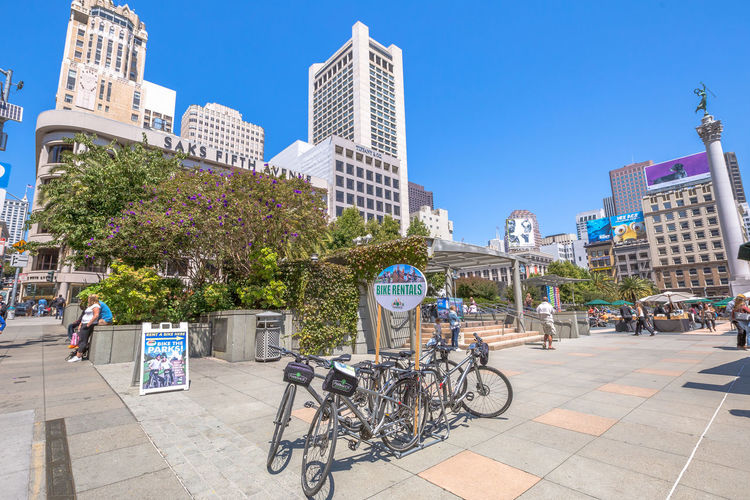 San Francisco, CA, United States - August 17, 2016: crowds of tourists in the popular Union Square, the central square of San Francisco on Market Street, known as the place shopping and luxury hotels. San Francisco, California, United States - August 17, 2016: the Big Bus, Hop On Hop Off, Sightseeing Tour, the popular double-decker bus carrying tourists, standing in Union Square, during a day tour. Cable Car California Market SF San Francisco Square Union Union Square SF United States Architecture Bicycle Building Exterior Built Structure City City Life Cityscape Clear Sky Day Incidental People Land Vehicle Large Group Of People Market Street San Francisco Market Street Mode Of Transport Modern Outdoors People Real People Sky Skyscraper Street Sunlight Transportation Travel Destinations Tree Union Square  Unionsquare