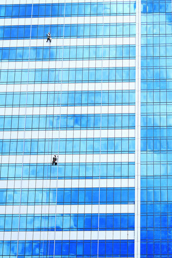Jobs Big Machines Building Building Exterior Cleaning My Account At EyeEm Construction Development Hardhat  Jobs Low Angle View Outdoors Sillhouette Sillouette Sky Window Woman Working