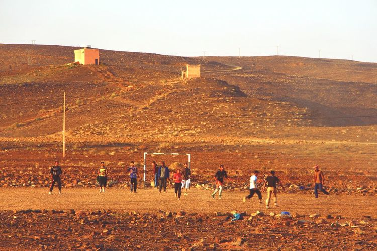 Moroccan football game! So much fun to see these kids playing and having a blast!! Sport Large Group Of People Teamwork Competition Soccer Football Blast Morocco Desert Arid Climate Dusk Sunset Having Fun Playing Kids Teenager Football Fever Championship Champions Ball TEAMS The Great Outdoors - 2017 EyeEm Awards Live For The Story Lost In The Landscape
