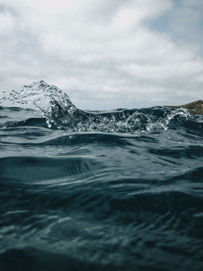 Surface level of sea against sky