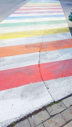 rainbow coloured crosswalk in antwerp, belgium Crosswalk Antwerp Colours Stripes Striped Street Concrete Asphalt Tarmac City Marking Road Marking Footpath Zebra Crossing Pattern Crossing Horizontal Lines Belgium Painted Image Rainbow Rainbow Colors Spectrum Color Colour