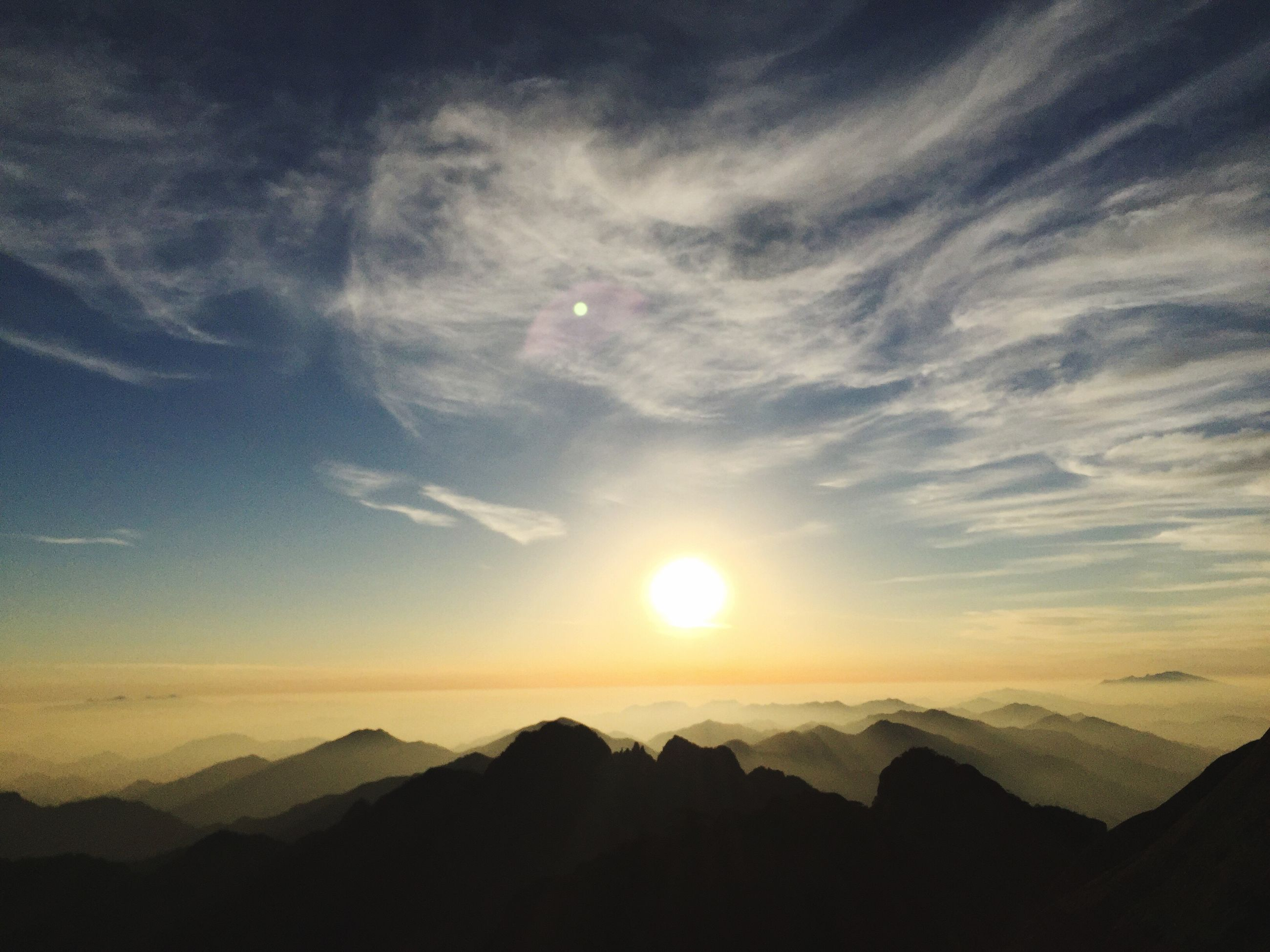 scenics, beauty in nature, sky, sun, sunset, nature, tranquility, silhouette, sunlight, no people, tranquil scene, sunbeam, outdoors, cloud - sky, landscape, mountain, astronomy, day