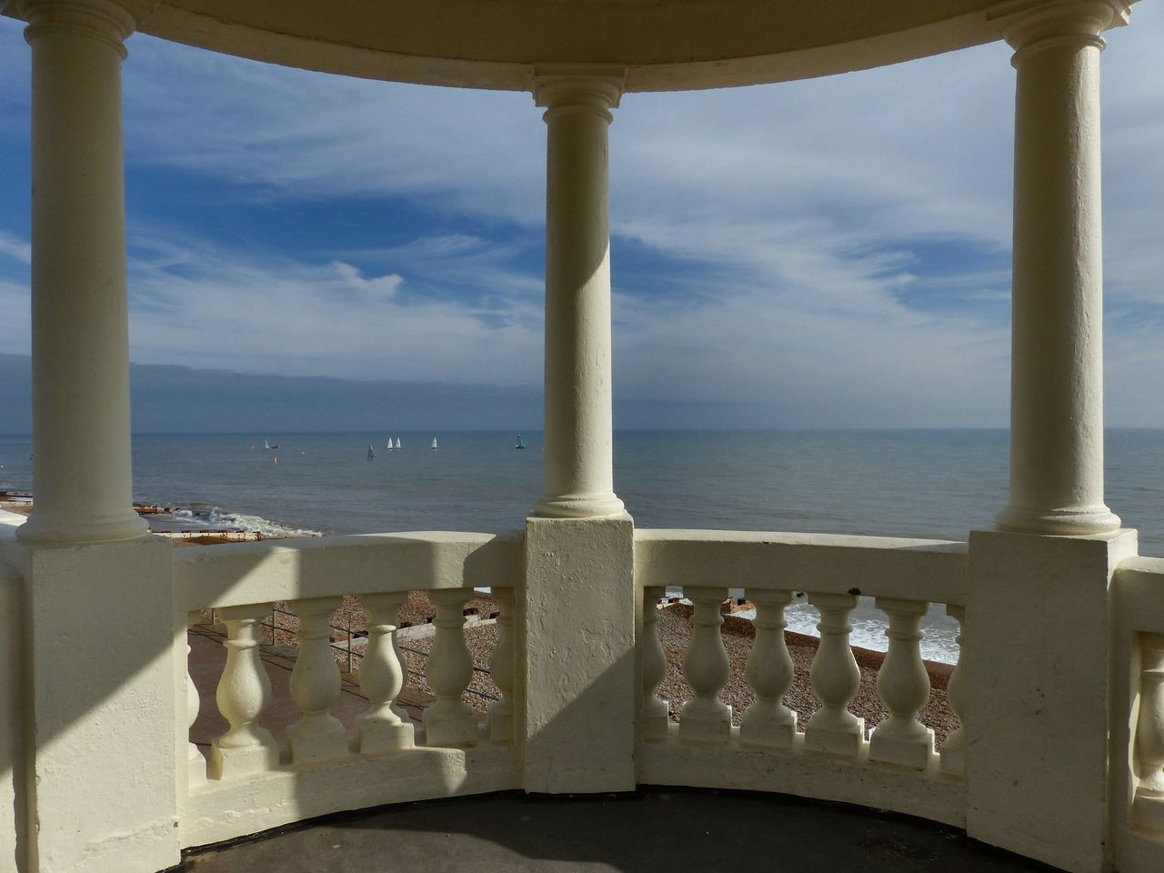 SCENIC VIEW OF SEA AGAINST SKY SEEN FROM RAILING