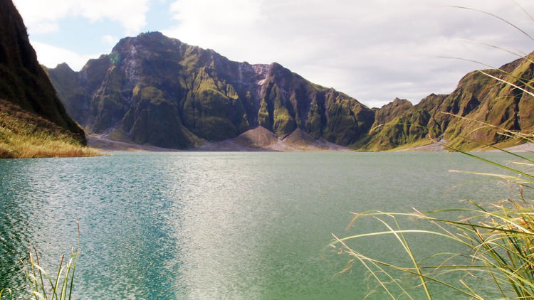 Mount Pinatubo Crater Lake Travel Wanderlust Beauty In Nature Crater Day Explore Lake Landscape Mountain Nature No People Outdoors Scenery Scenics Sky Tranquil Scene Tranquility Travel Destinations Volcanic Landscape Volcano Water