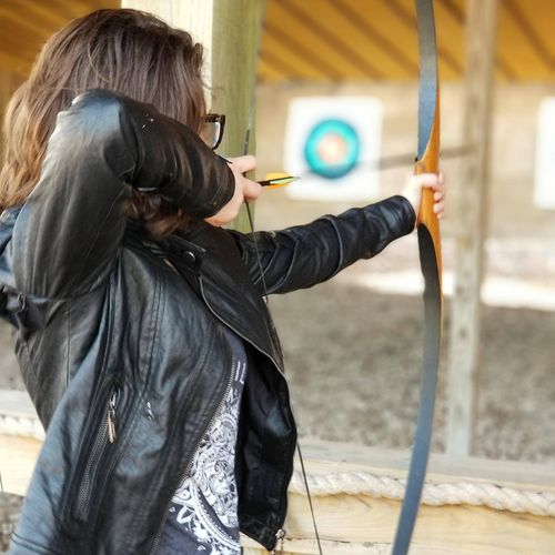 Young Woman Aiming With Archery Bow
