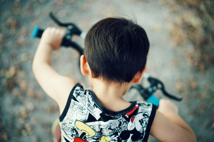bicycle ride Kidsphotography Kids Being Kids Kids EyeEmNewHere People Playing EyeEm Kids City Child Headshot Rear View Waist Up Close-up Body Adornment Self Portrait Photography Hairy  Photographing Human Back Back Backache