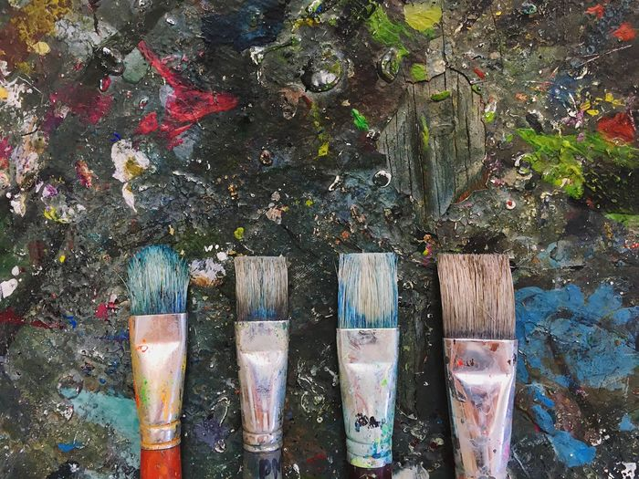 Brushes coverd with paint No People High Angle View Paint Wood - Material Day Outdoors Oil Paint Palette Close-up Art Colorful Brushes Painter Workshop Art Studio Work Tool Variation Art And Craft Equipment Art And Craft Oil Paint Indoors  Multi Colored Paint Paintbrush Backgrounds