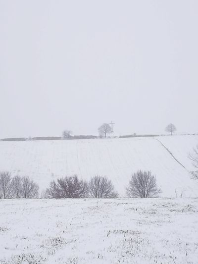 Scenic view of snow field against clear sky