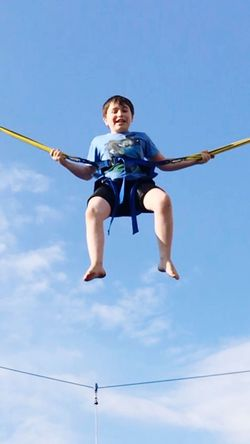 Flying High Low Angle View One Person Full Length Boys Sport Blue Childhood Sky Day Outdoors One Boy Only Playing Real People Child Sports Uniform Competition People Sommergefühle EyeEm Selects Adobe Stock Getty Images Breathing Space