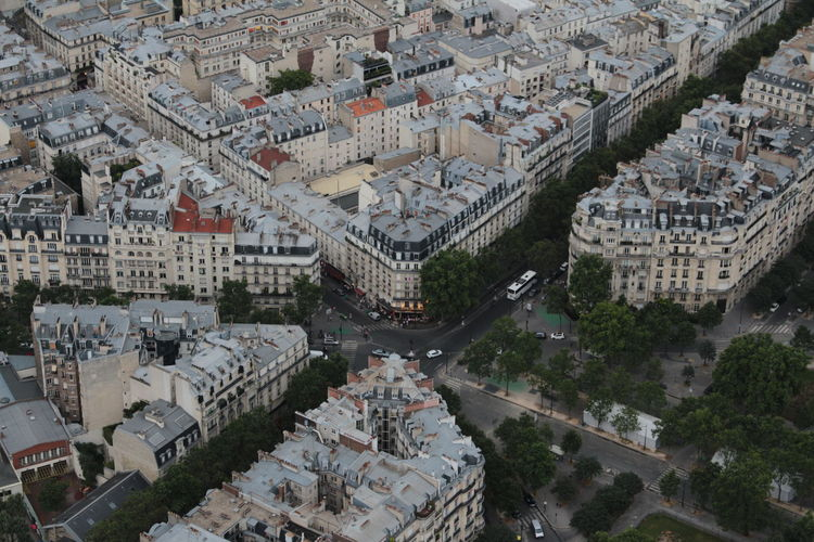 Paris, france from the eiffel tower. high angle view of buildings in city against cloudy sky