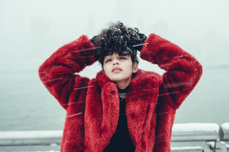 Beauty In Nature Childhood Close-up Cold Temperature Day Elementary Age Front View Girls Jacket Leisure Activity Lifestyles Looking At Camera Nature One Person Outdoors Portrait Real People Red Scarf Snow Standing Waist Up Warm Clothing Weather Winter