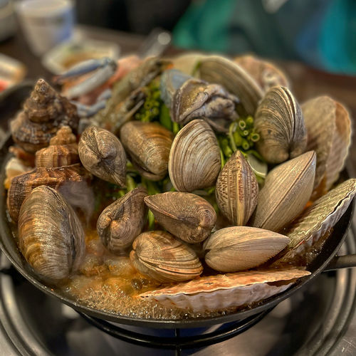 High angle view of clams in container on table