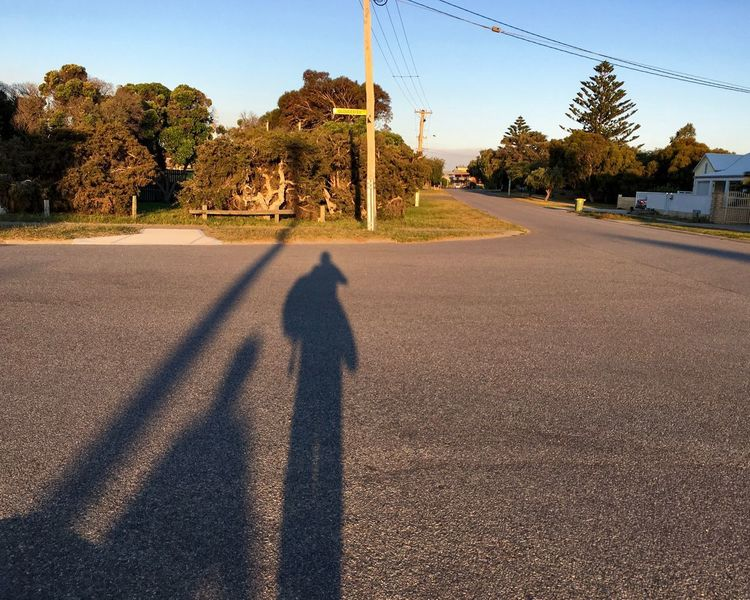Gloucester Road Sign Street Lamp Post Cables Clear Sky Travel Waiting For The Bus On The Road Roadside Neighbourhood Residential  October 2016 Sunlight Shadow Tree Plant Road Focus On Shadow Long Shadow - Shadow Outdoors Day Summer Road Tripping