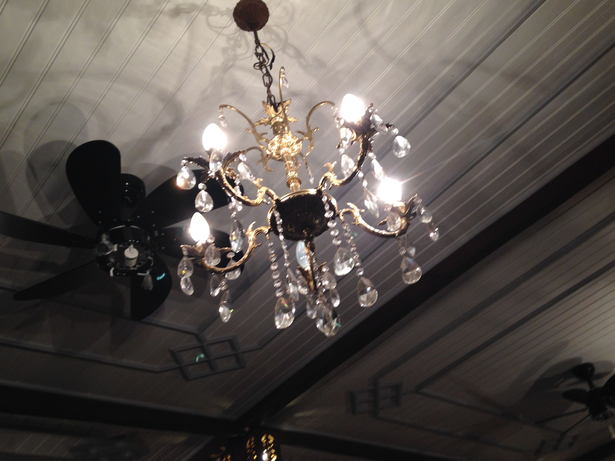 indoors, hanging, lighting equipment, ceiling, illuminated, decoration, chandelier, electric lamp, electricity, low angle view, decor, electric light, home interior, lantern, light bulb, table, lamp, no people, wall - building feature, light - natural phenomenon