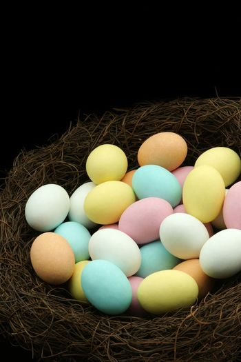 Pastel easter eggs in a nest Easter Candy  Chocolate Eggs Easter Nest Copy Space Pastel Nobody Easter Easter Eggs Egg Food Food And Drink No People Holiday Easter Easter Egg Large Group Of Objects Multi Colored High Angle View Variation Studio Shot Black Background